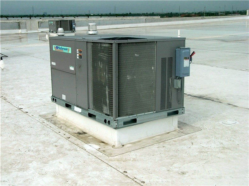A curb-mounted HVAC unit on a TPO roof.