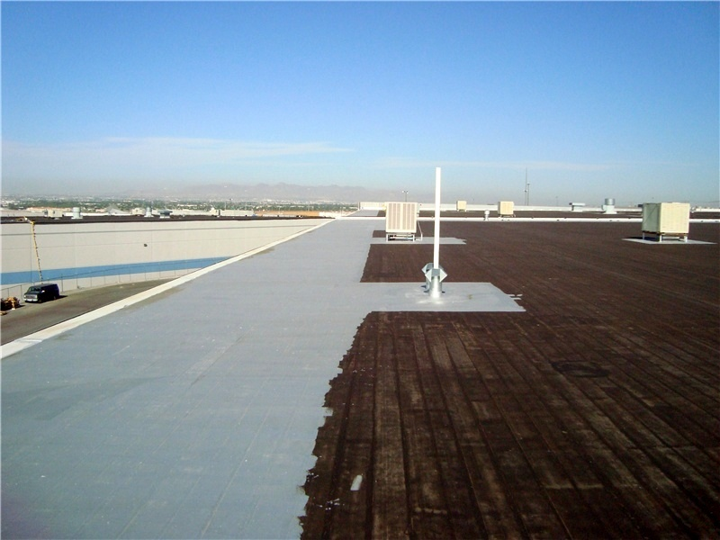 A reflective aluminum roof coating is applied as a protective surface on a new built-up roof.