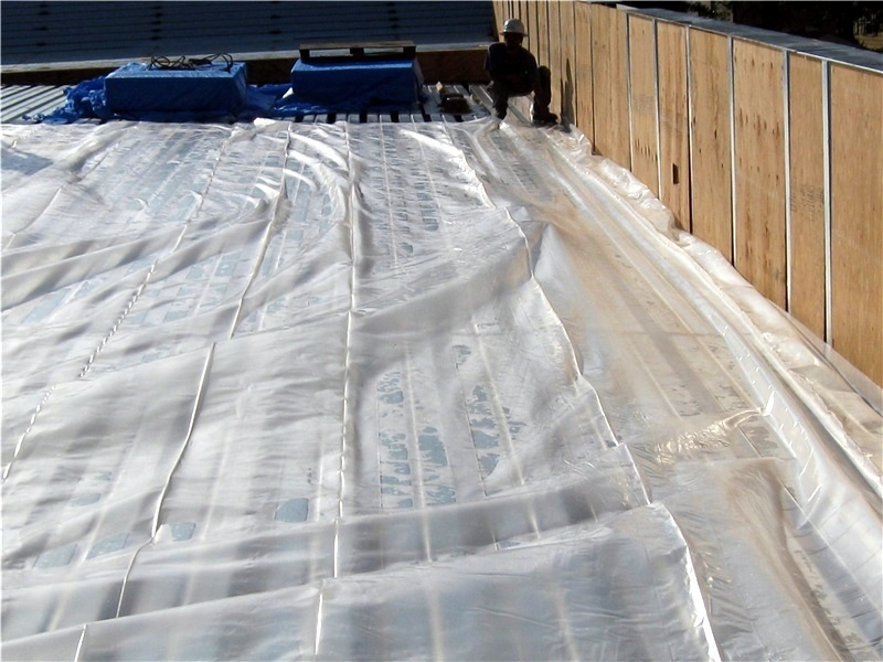 Polyethylene sheeting installed as a vapor barrier on this steel roof deck.