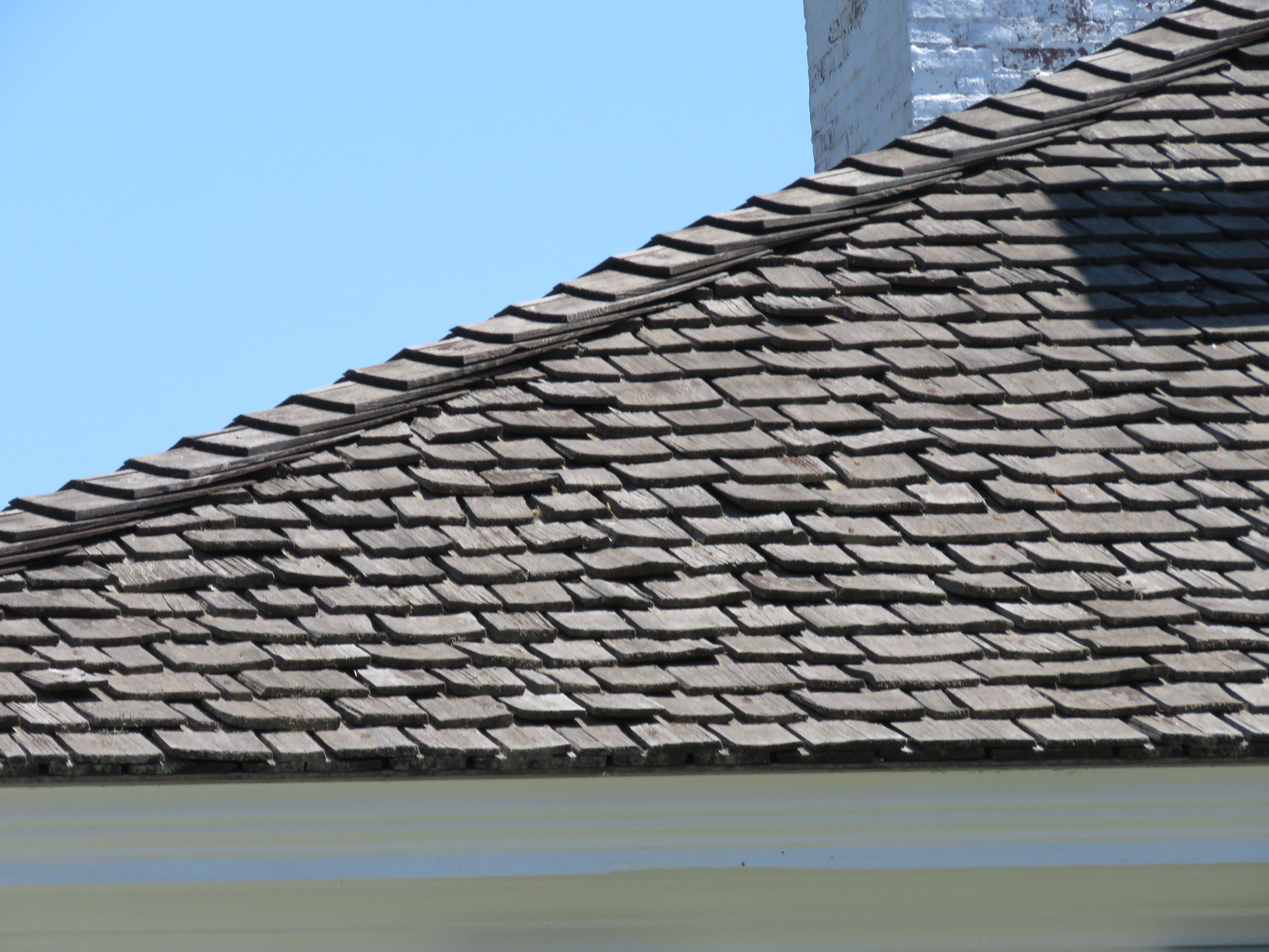 An aged wood shake roof.
