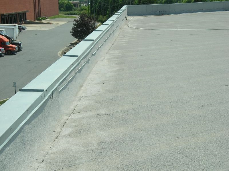 Galvanized steel coping with standing seam joints.