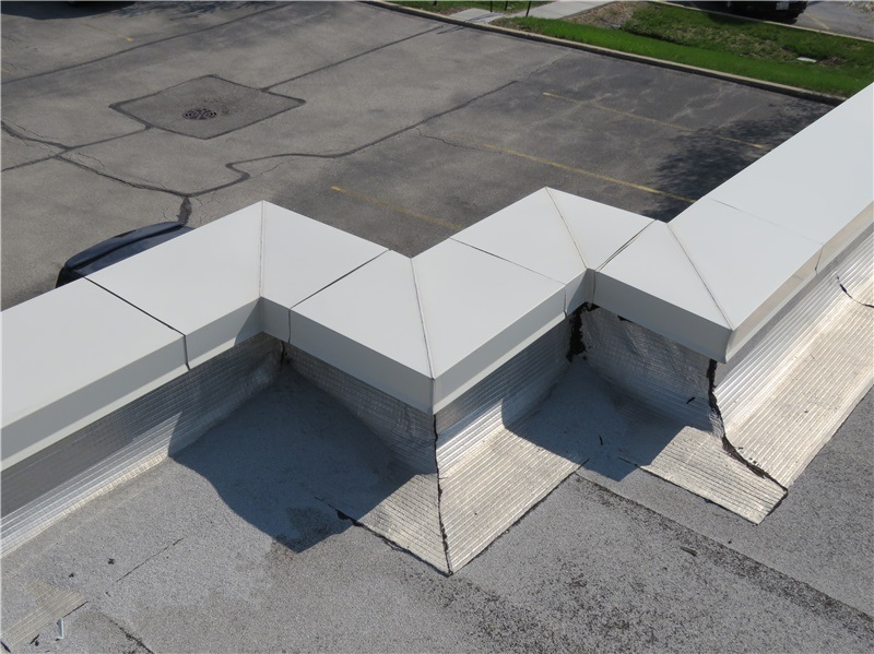 Coated aluminum coping with pre-fabricated corners.