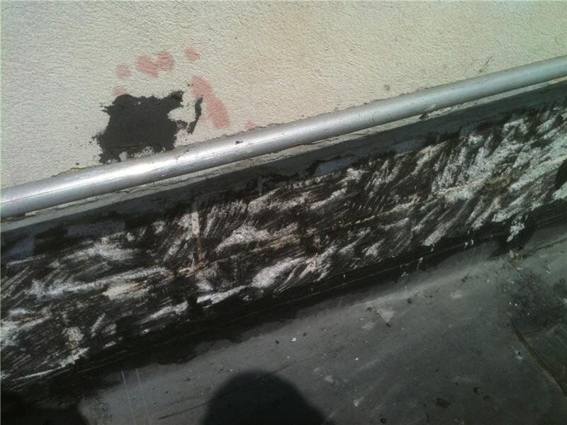 A white residue on aged asphalt-based roofing materials may indicate the presence of asbestos.