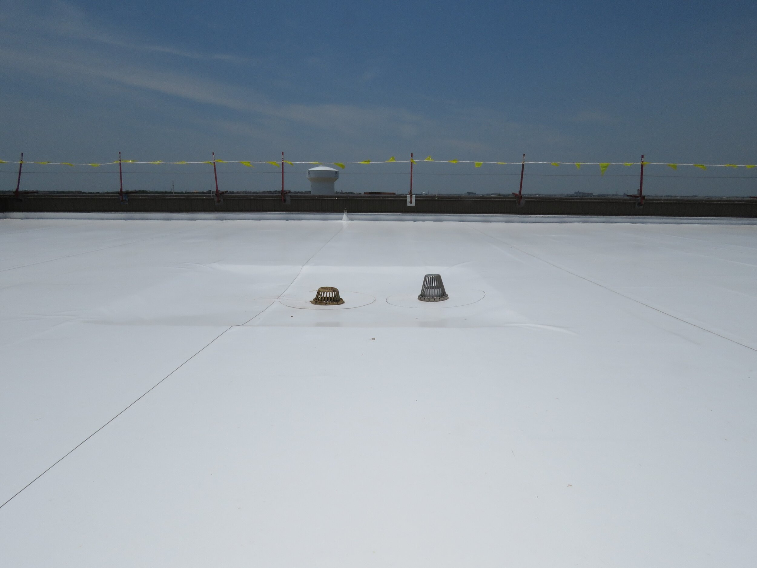 A newly-installed PVC single-ply roof membrane