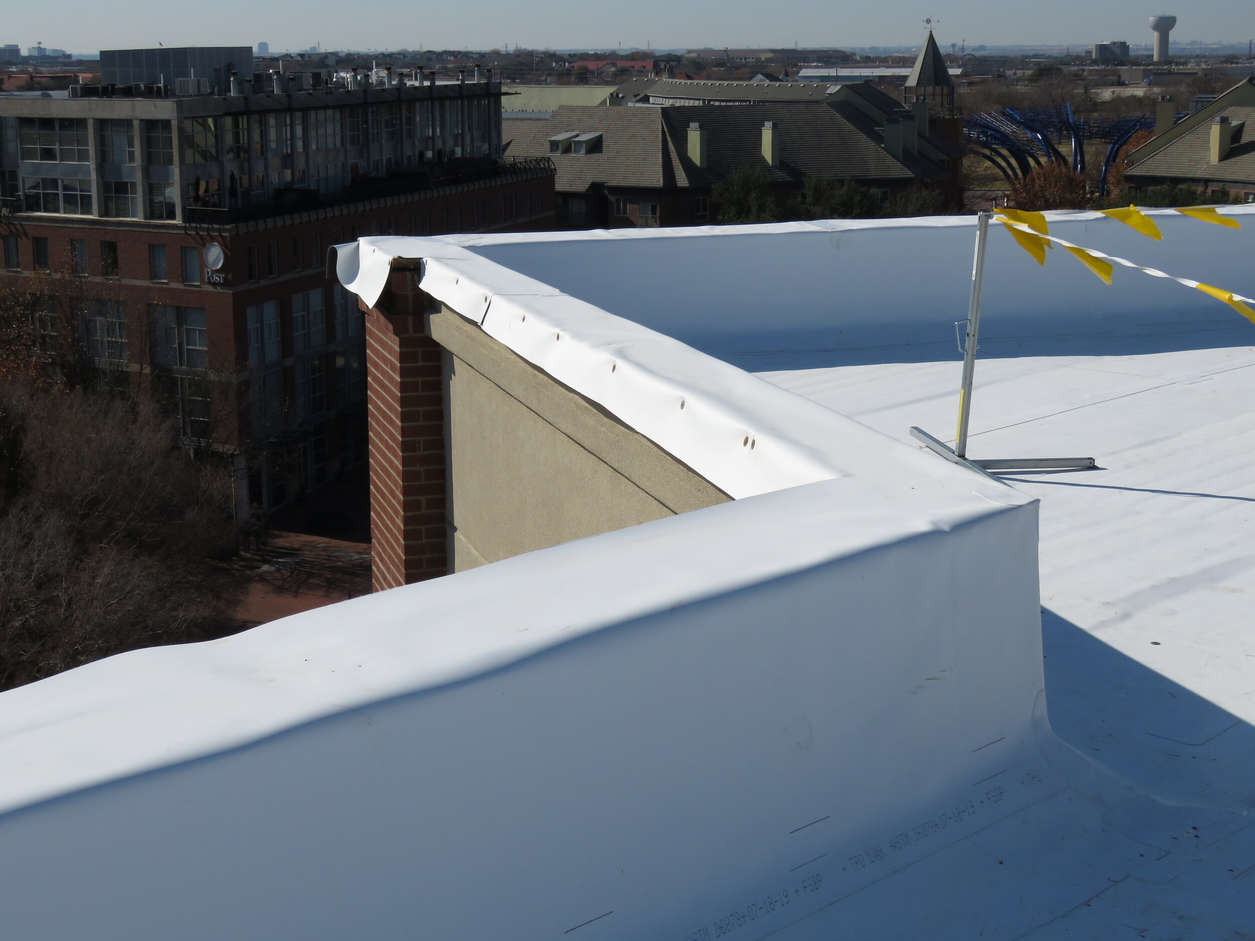 A TPO single-ply roof membrane during installation