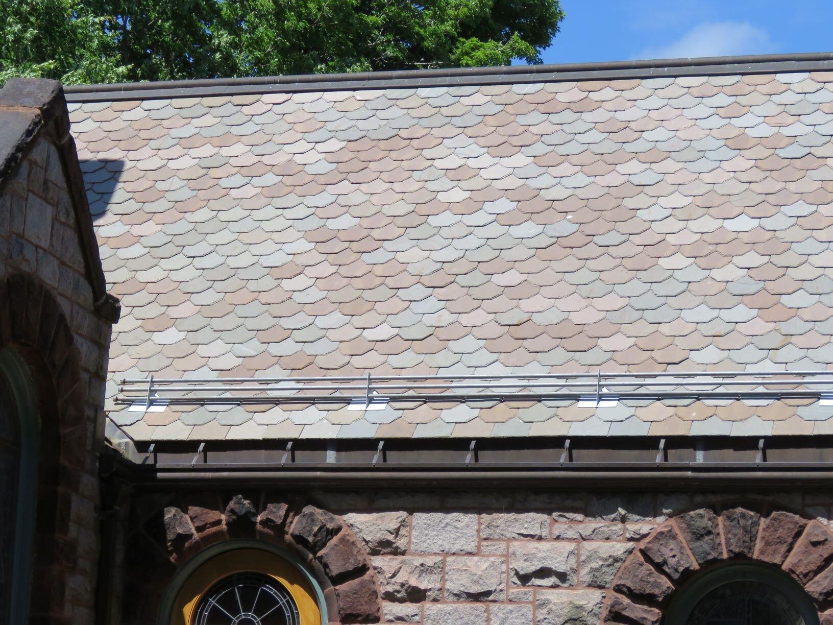 Multi-colored slate roof.