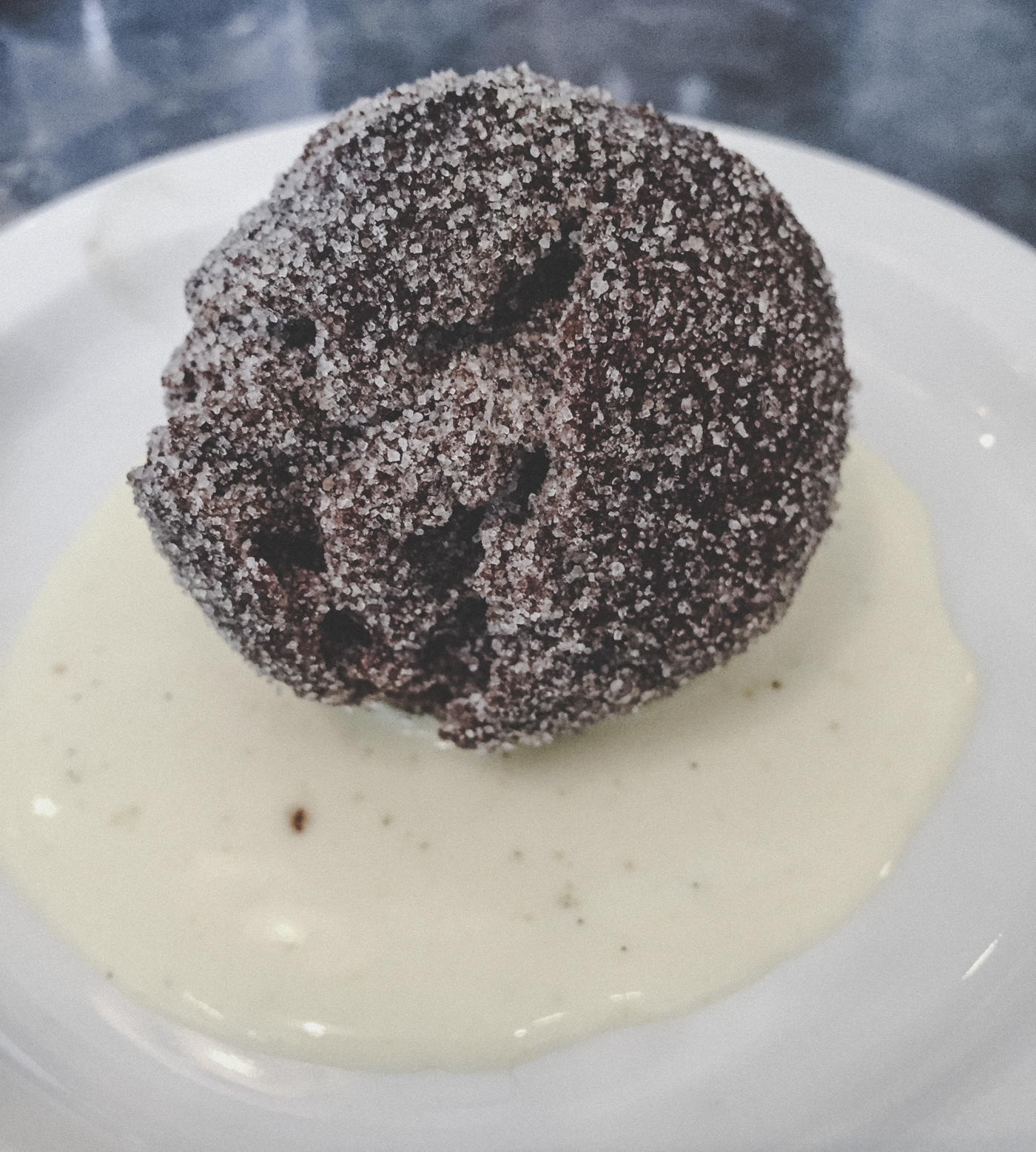 Chocolate potato doughnut with creme anglaise at  Tasty n Sons .