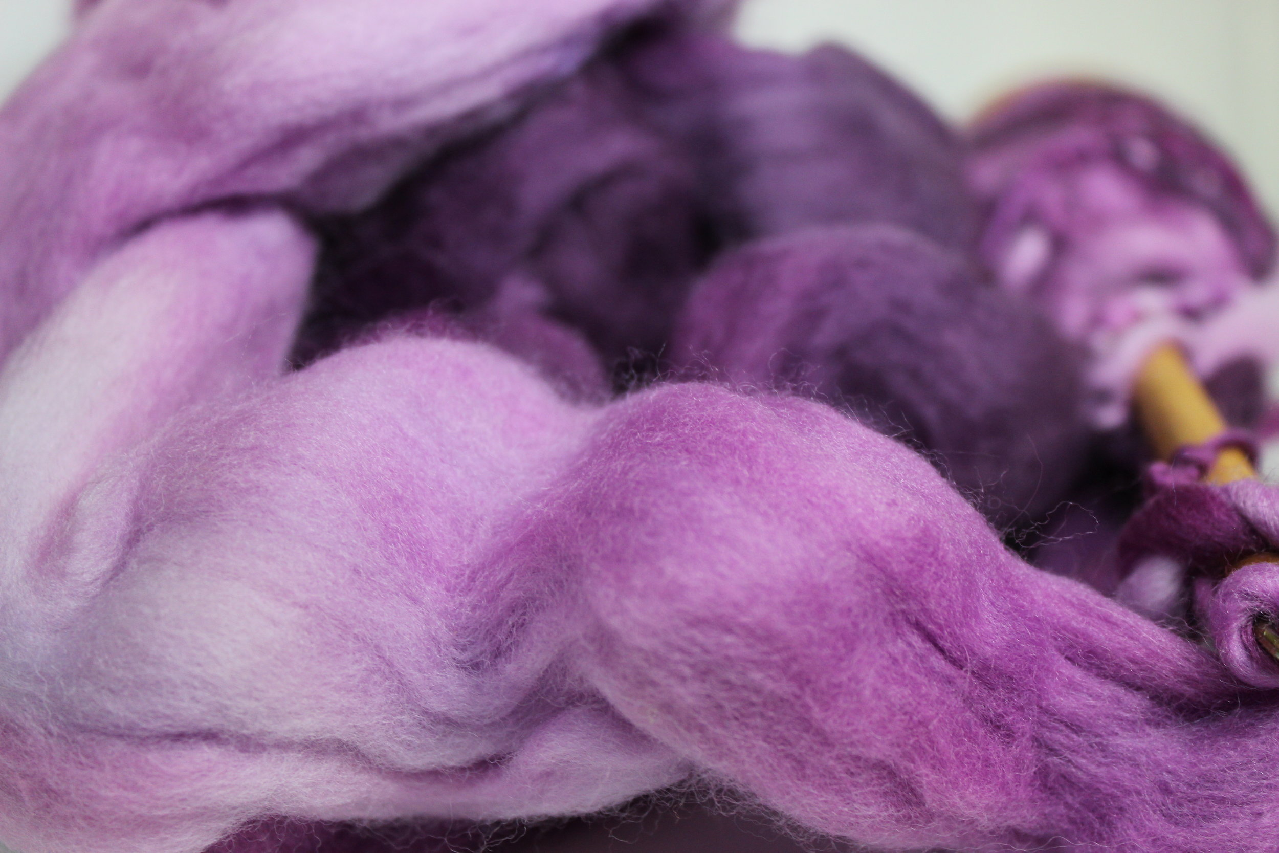 yarn on a spindle purple