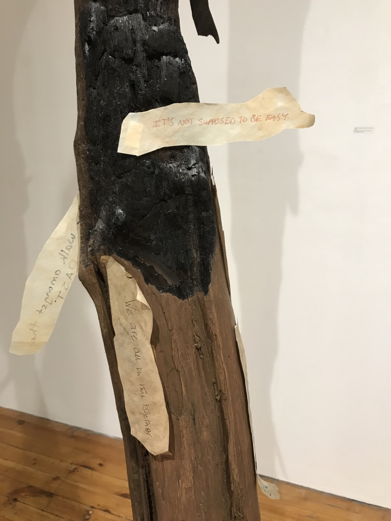 """Around The World: Unity in Diversity  (Detail) ,  2017 - 2018 12 driftwood tree trunks, multi-cultural fabrics, paper """"barks"""""""