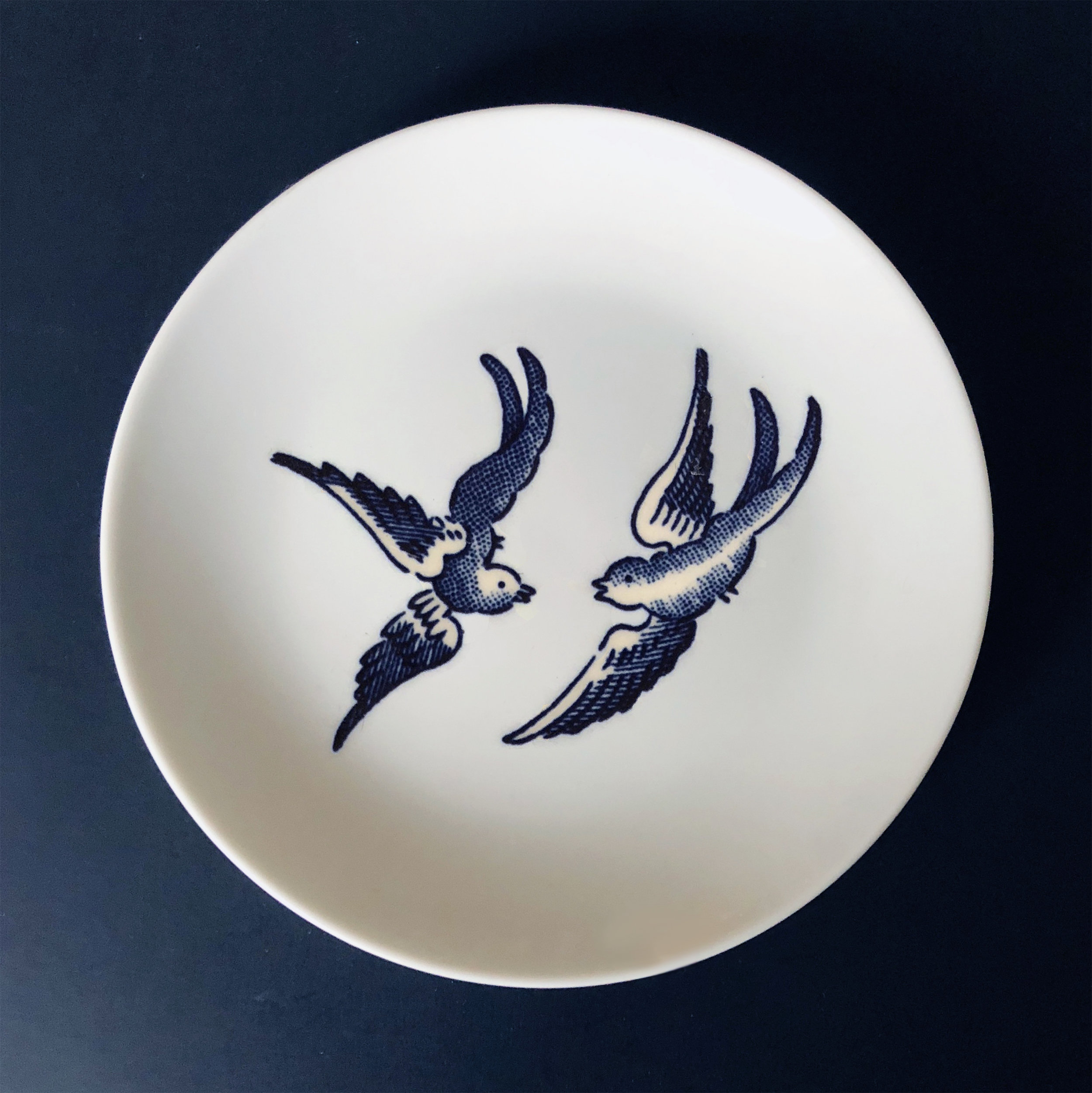 "Blue Willow Bird 2 , 2019, custom ceramic decal on a ceramic plate, 6"" in diameter"