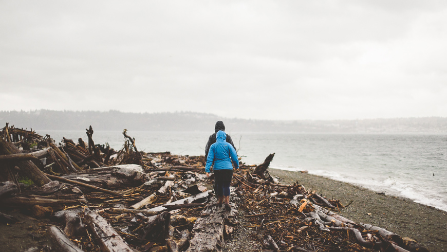 002 couple walking along driftwood beach washington state nathan mitchell photography