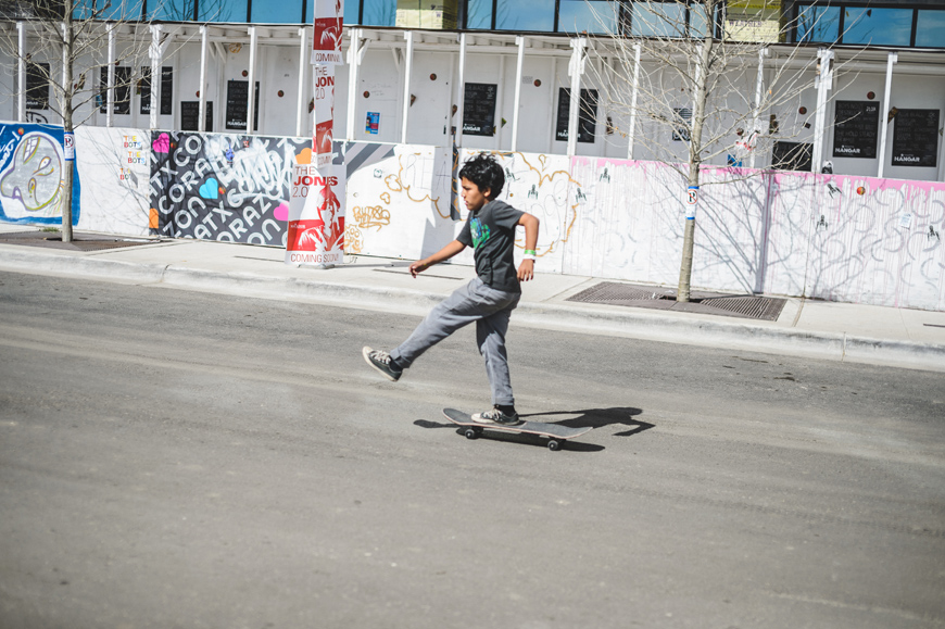 016-Kid-skateboarding-down-5th-St.-in-Austin-Texas.jpg