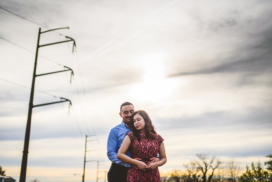 006 couple embracing in front of cloudy skies.jpg