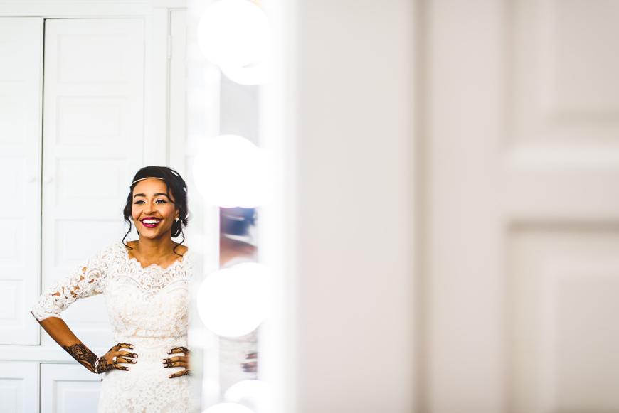 004 beautiful bride laughing in mirror.jpg