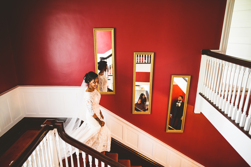 007 bride descending stairs during first look.jpg