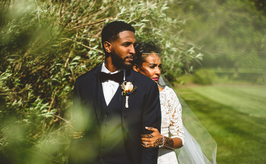 011 bride and groom look off into distance in greenery.jpg