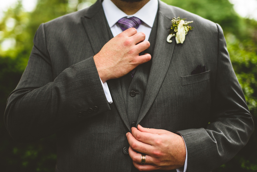 001 groom adjusting wedding suit richmond virginia.jpg