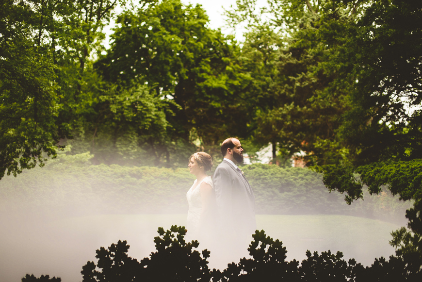 005 creative portrait bride and groom with back to each other.jpg