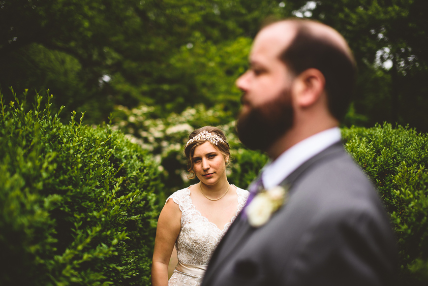 008 groom out of focus in foreground with bride looking at camera.jpg