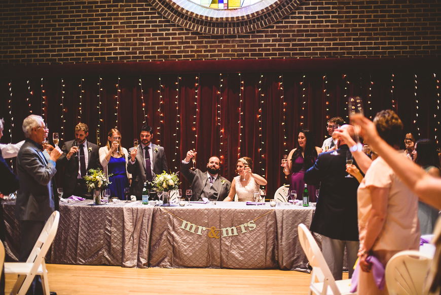 013 bride and groom raise their glasses to wedding guests.jpg