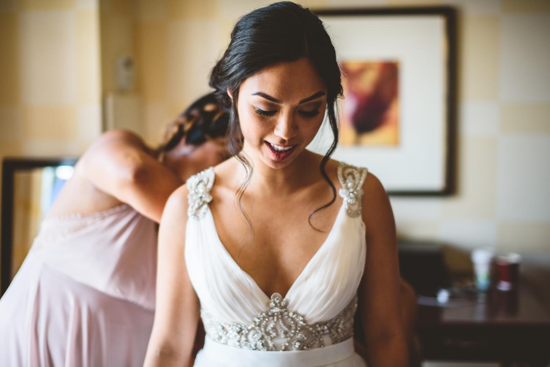 006 bride in wedding dress in hotel room.jpg