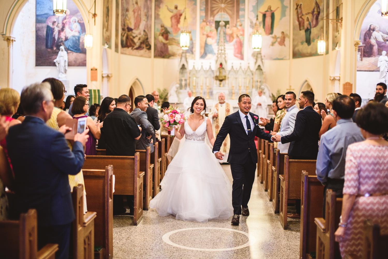 017 bride and groom walking down the aisle.jpg