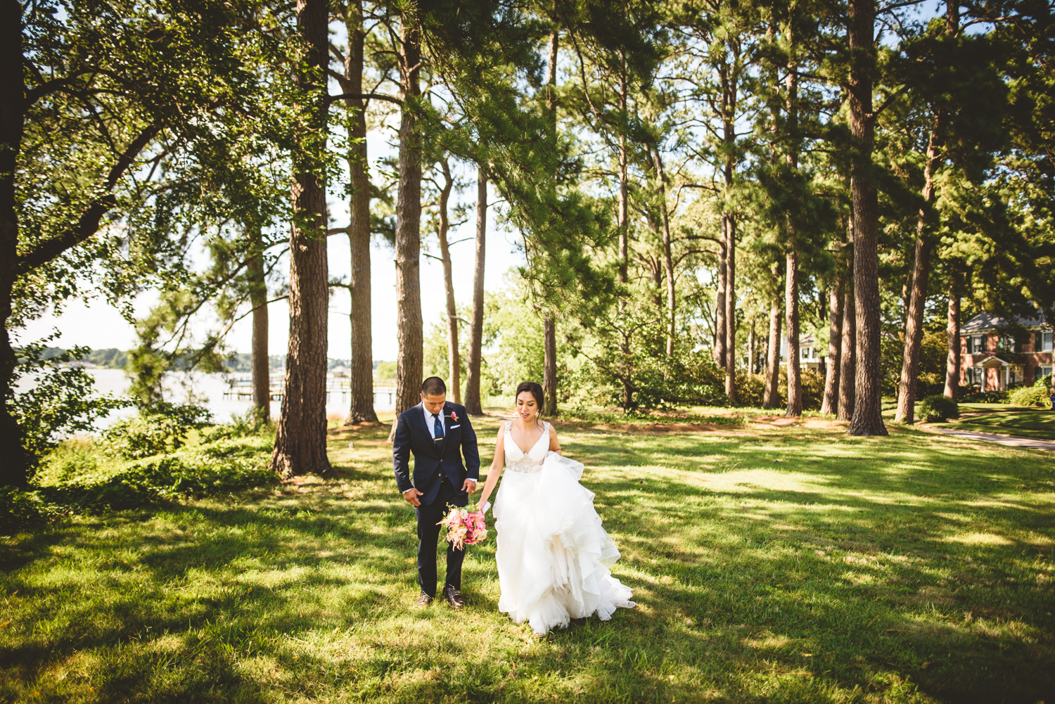 024 bride and groom walk among the trees after getting married.jpg
