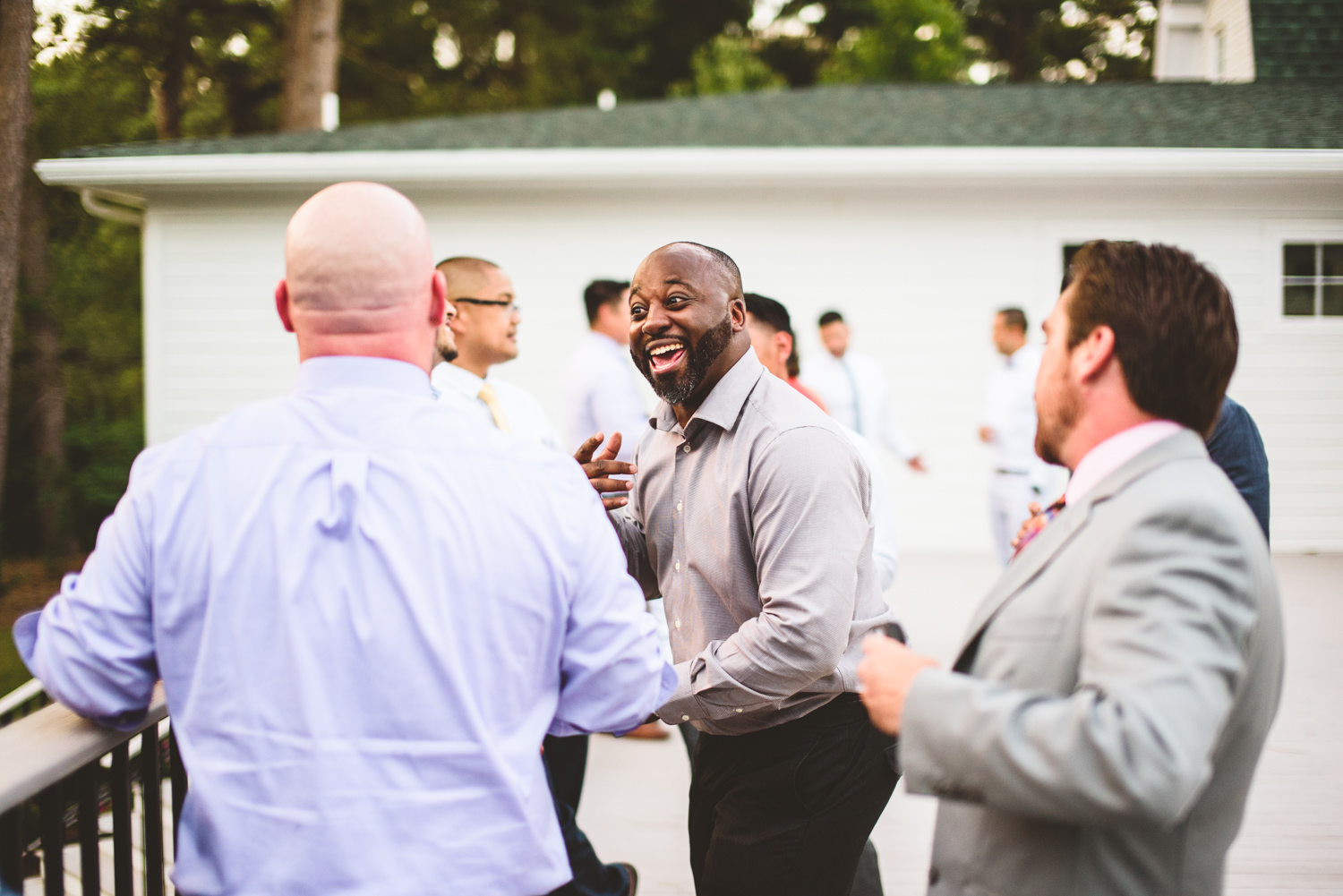043 wedding guests laughing together.jpg