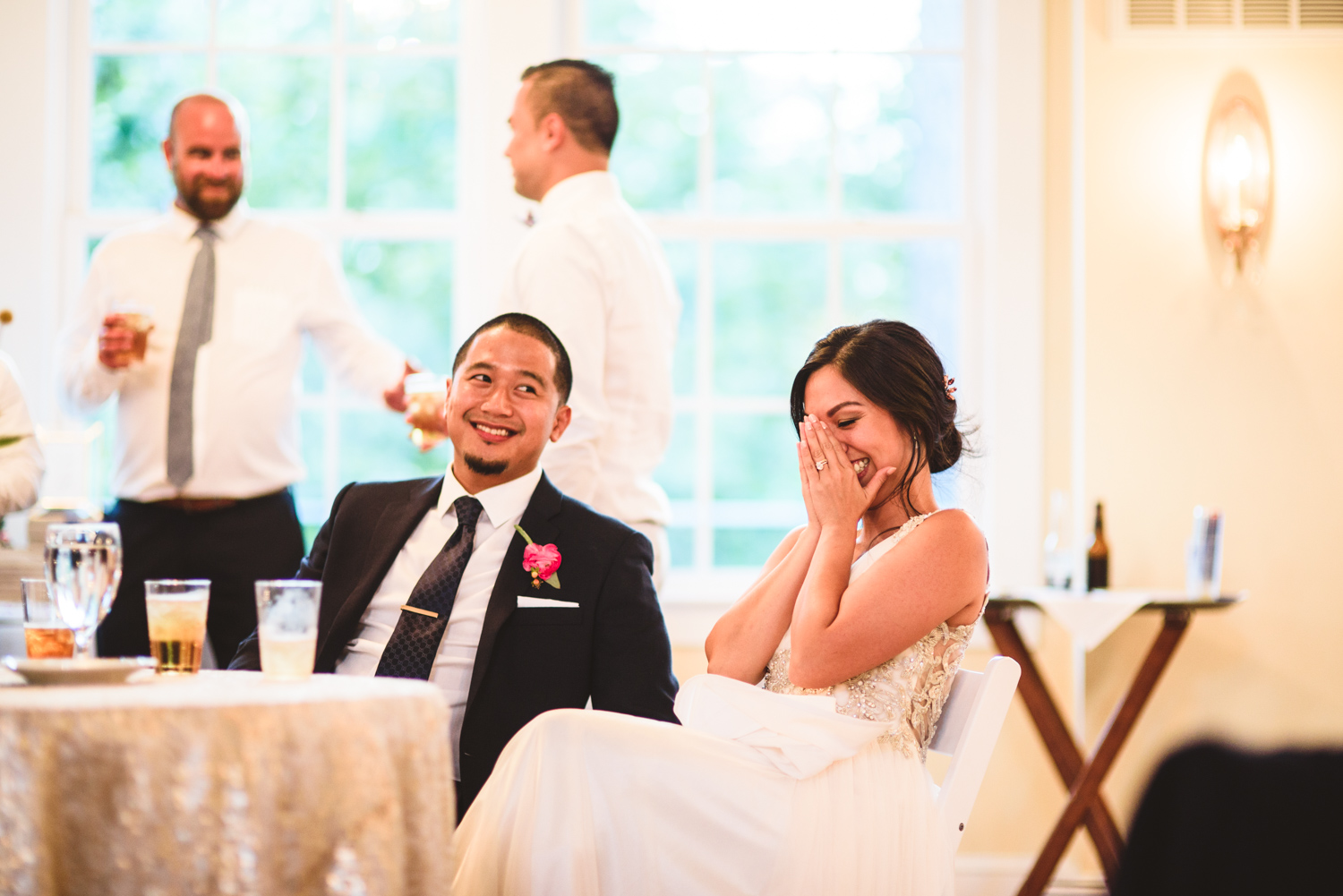 044 bride covers her face during toasts.jpg
