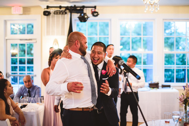 046 groom laughs with groomsman.jpg