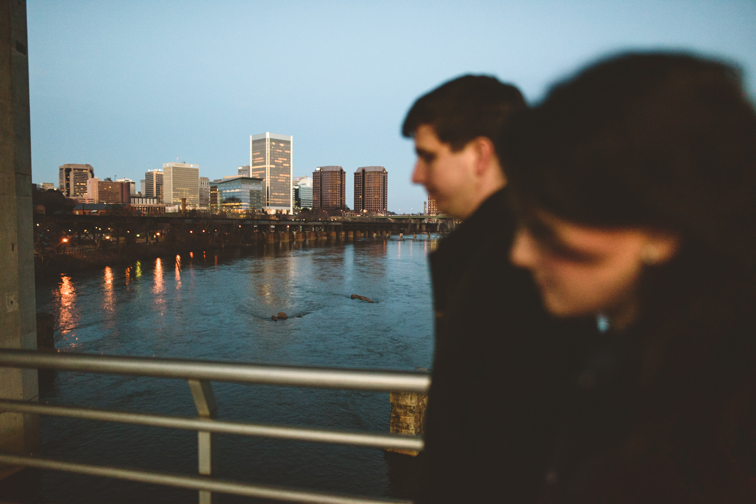 012 - couple walking along the belle isle walking bridge richmond virginia engagement photographer nathan mitchell.jpg