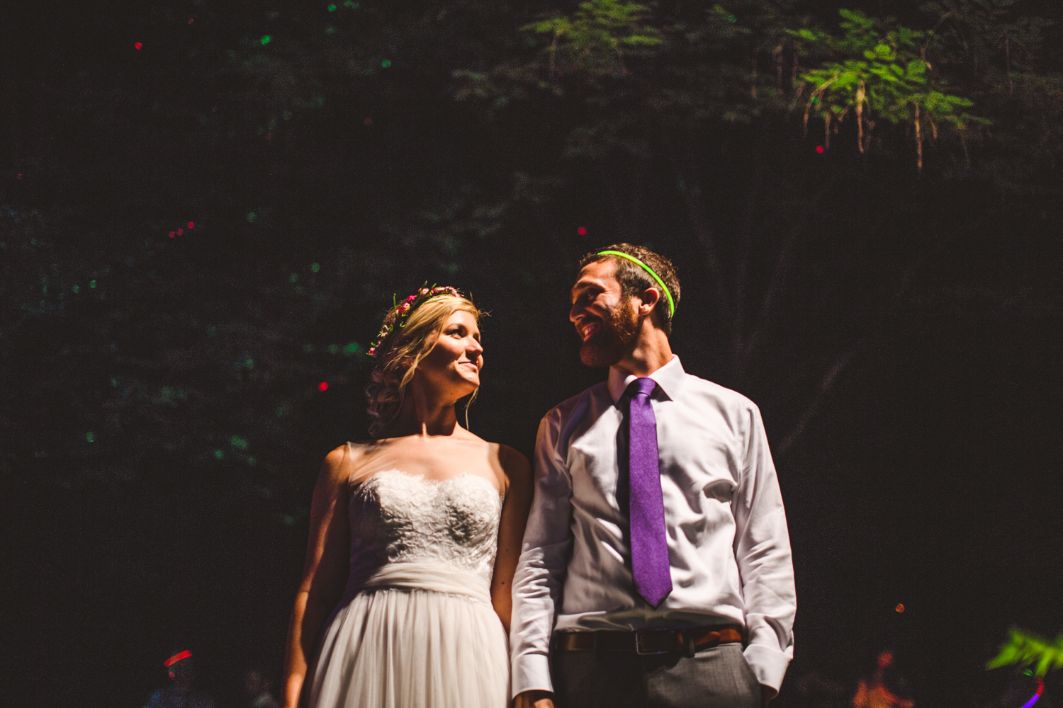 030a - night portrait of bride and groom in front of neon trees.jpg