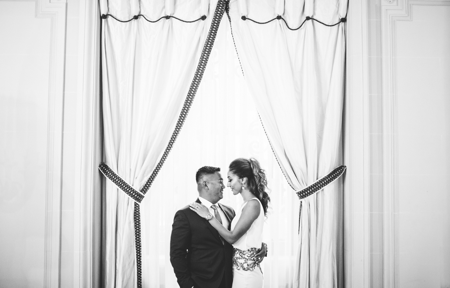 004 black and white portrait of a couple in front of a window in Washington DC.jpg