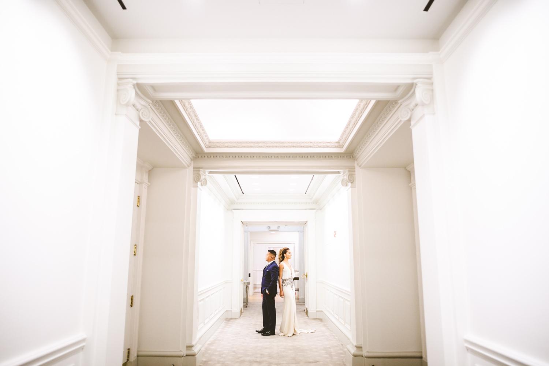 006 - wide engagement portrait in hotel hallway.jpg