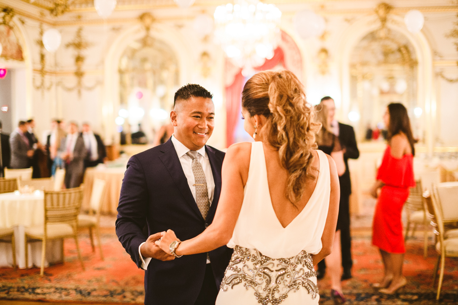 009 bride to be and groom to be share a dance at their engagement party in washington dc.jpg