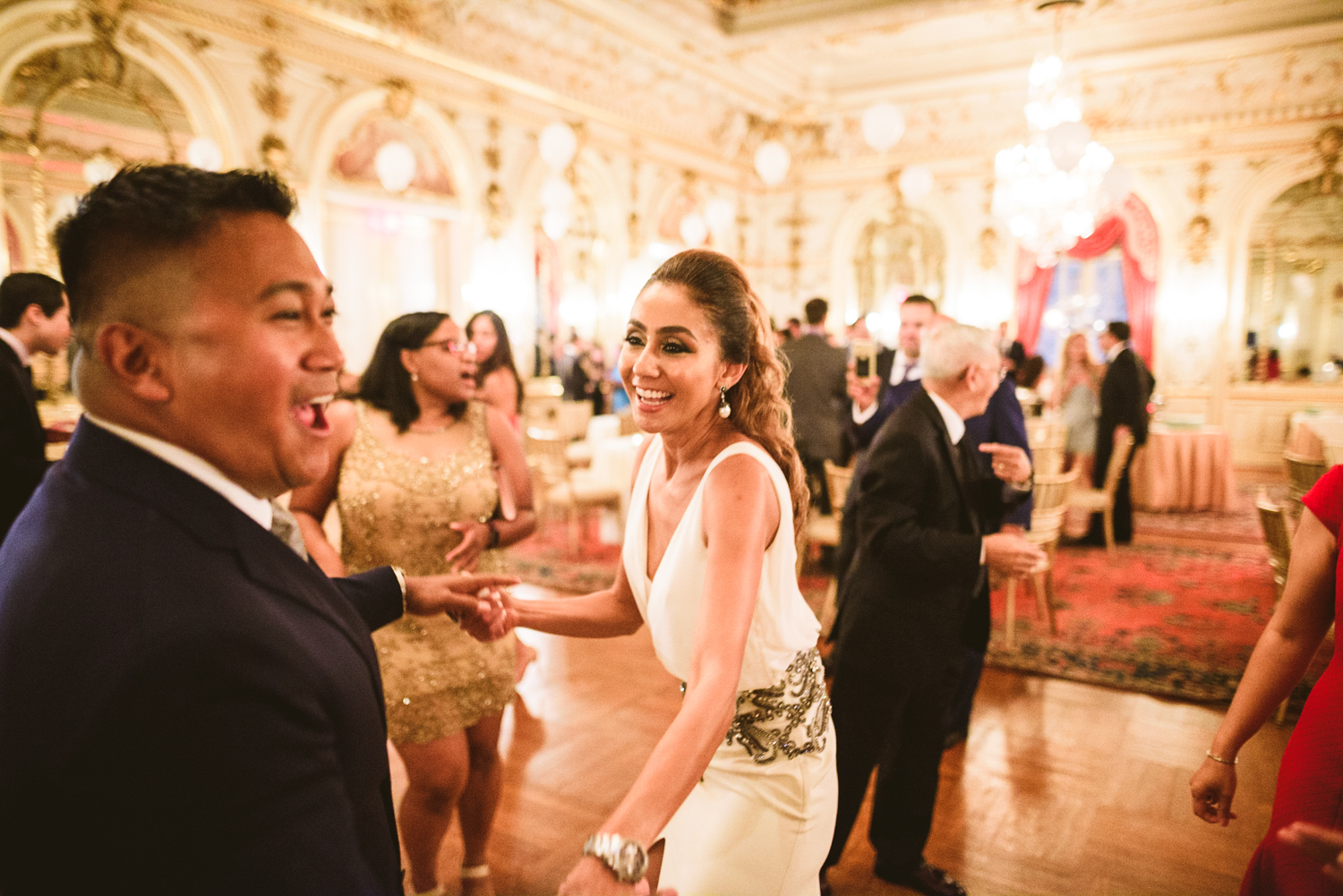010 bride to be and groom to be share a dance at their engagement party in washington dc.jpg