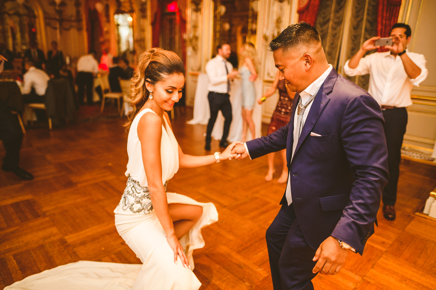 017 bride to be and groom to be share a dance at their engagement party in washington dc.jpg