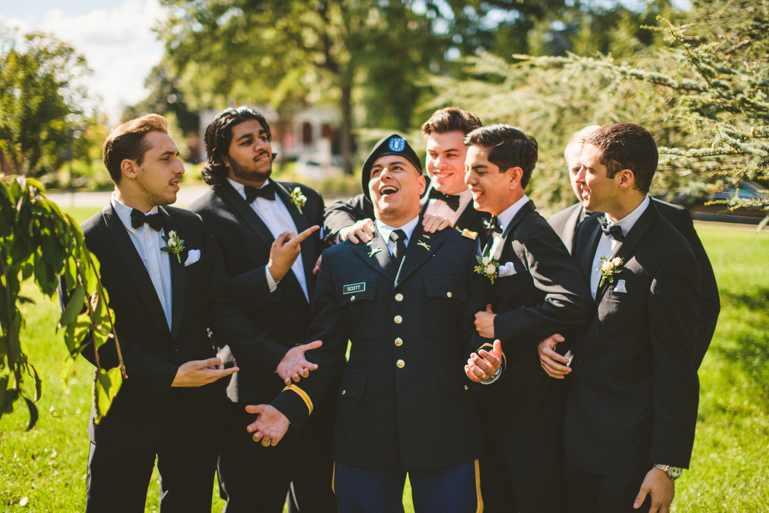 010 groomsmen and the groom being funny during portraits.jpg