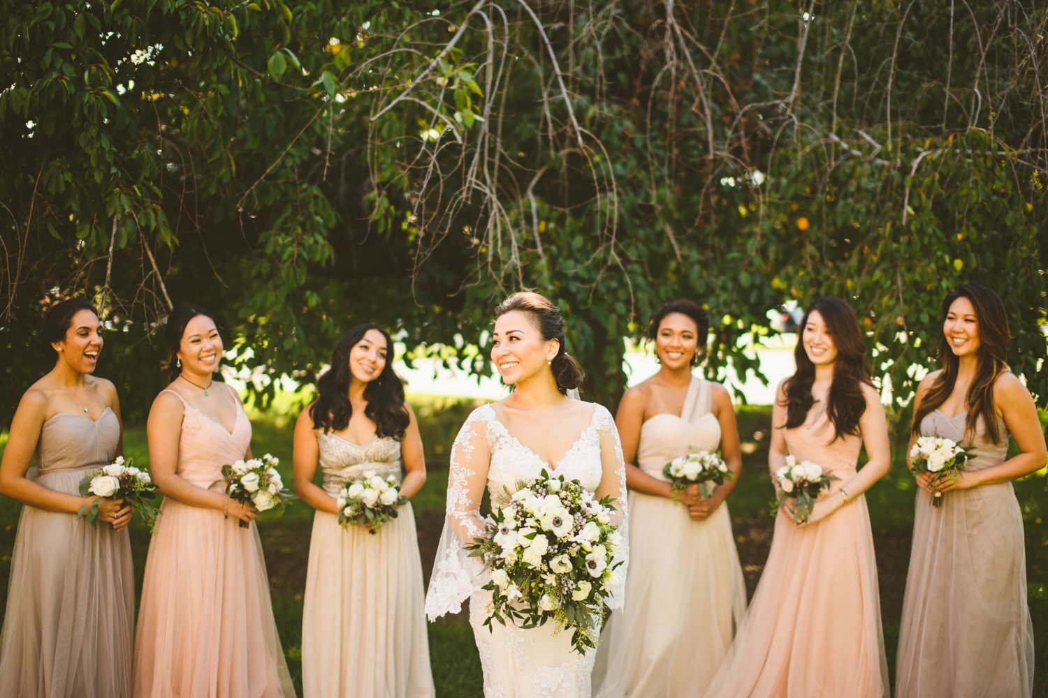011 bride and bridesmaids laughing together.jpg