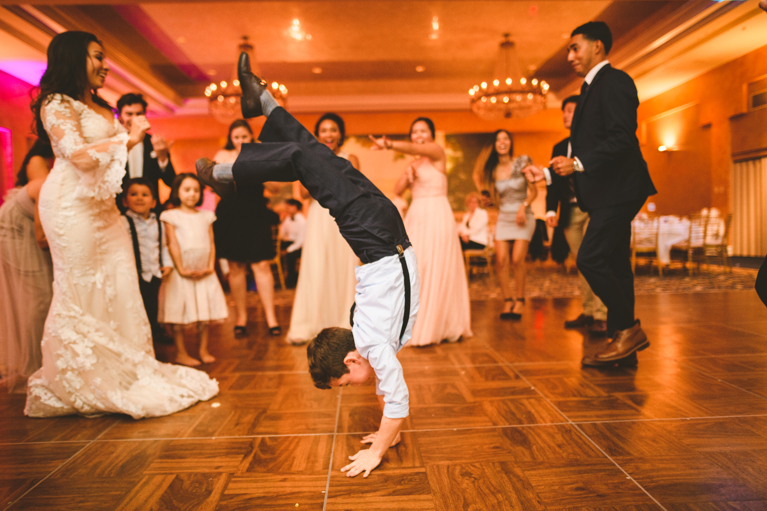 021 kid does a handstand at a military wedding.jpg
