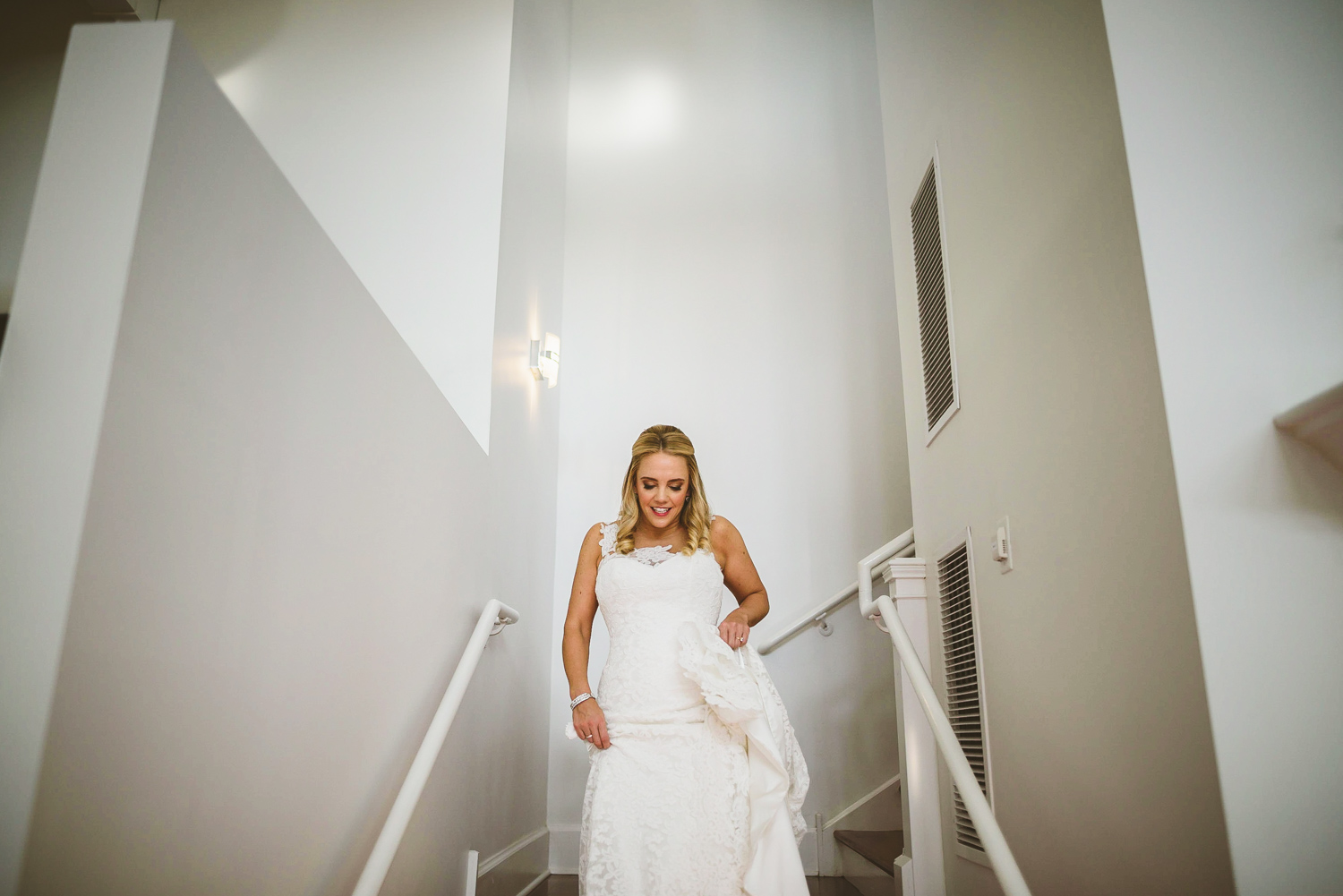 002 - bride walking down stairs at upper shirley vineyards.jpg