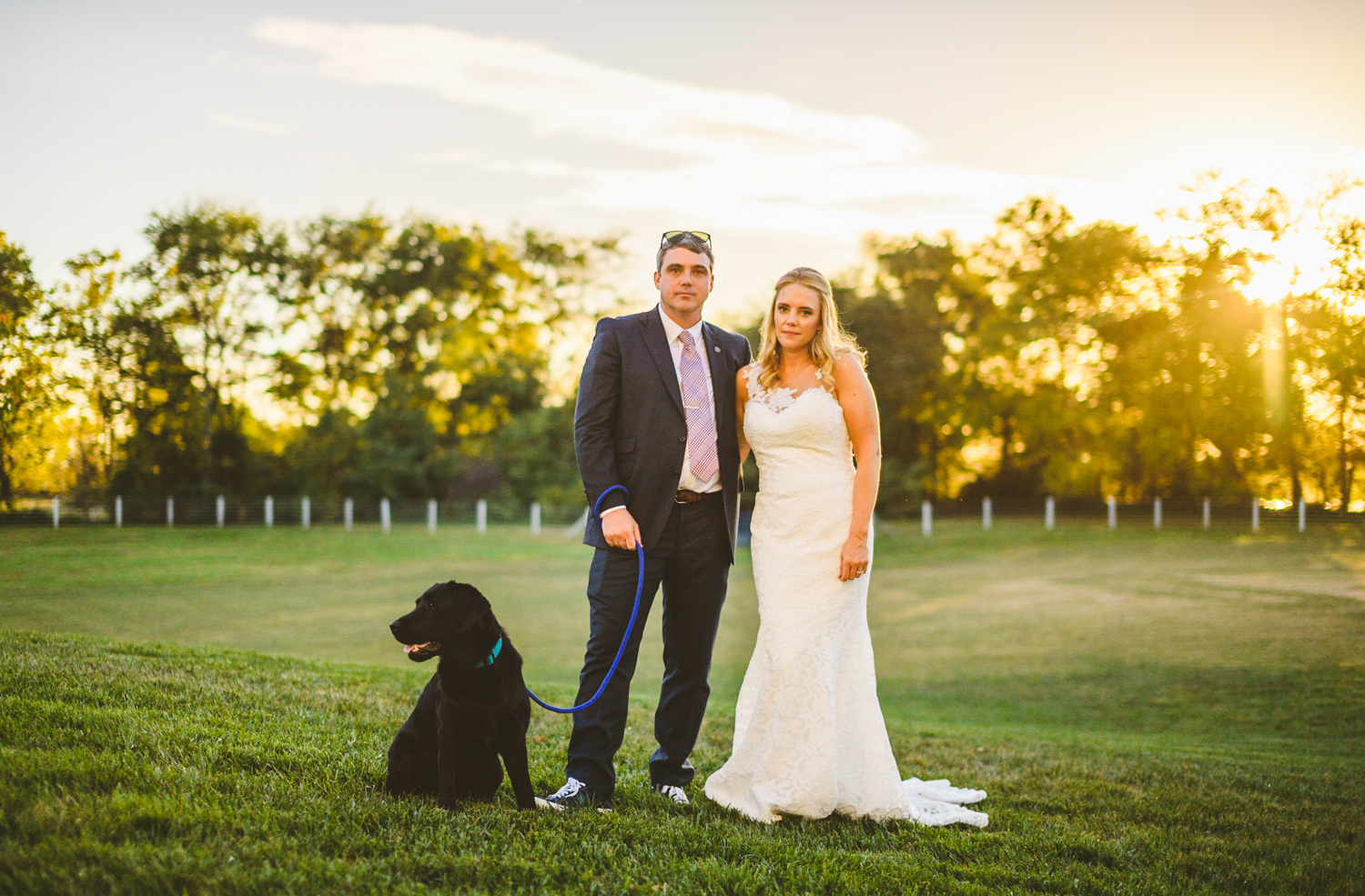 011 - the bride and groom and their dog pose for a wedding photo.jpg