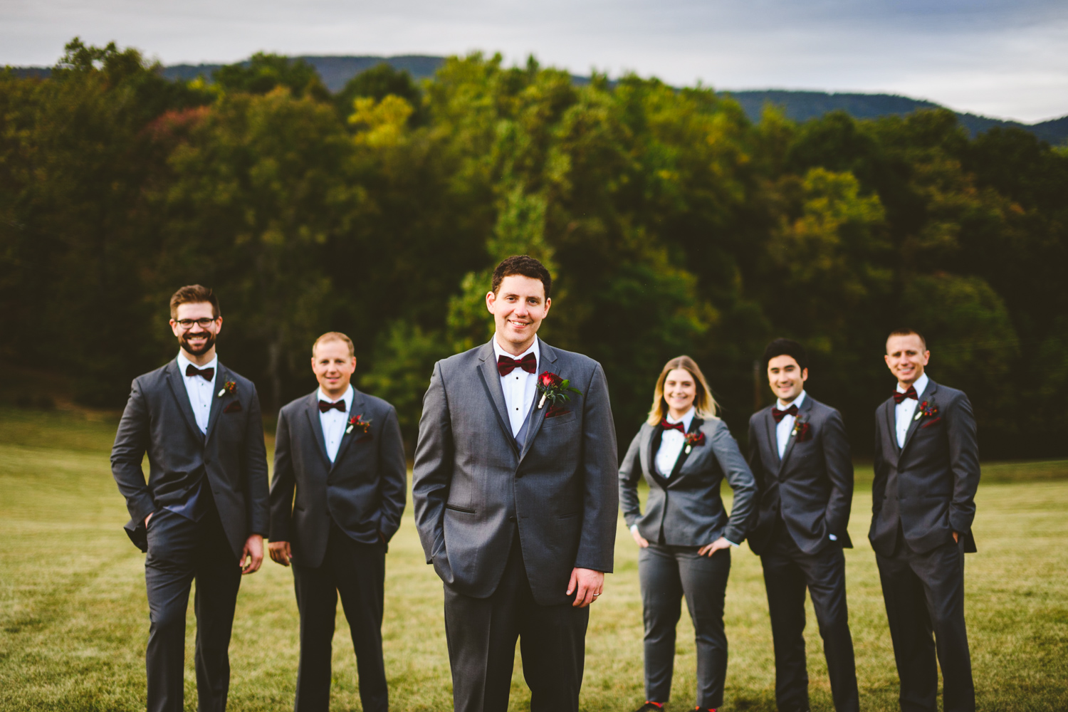 005 - groom and groomsmen portrait on a hill.jpg