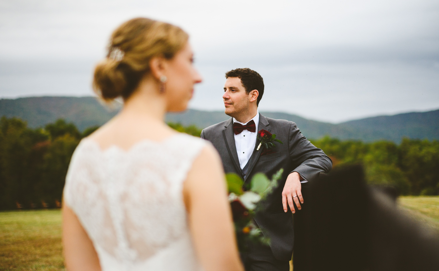 006 - wedding portrait focus on groom with bride out of focus in foreground.jpg