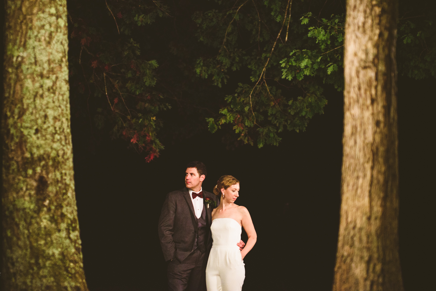 016 - bride in wedding jumpsuit poses for a night portrait in virginia forest.jpg