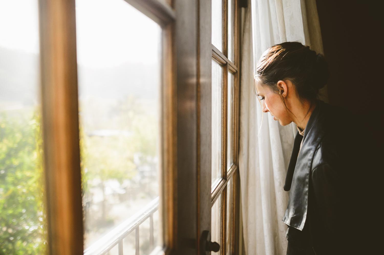 006 - bride looks at the window of the vineyard bridal suite.jpg