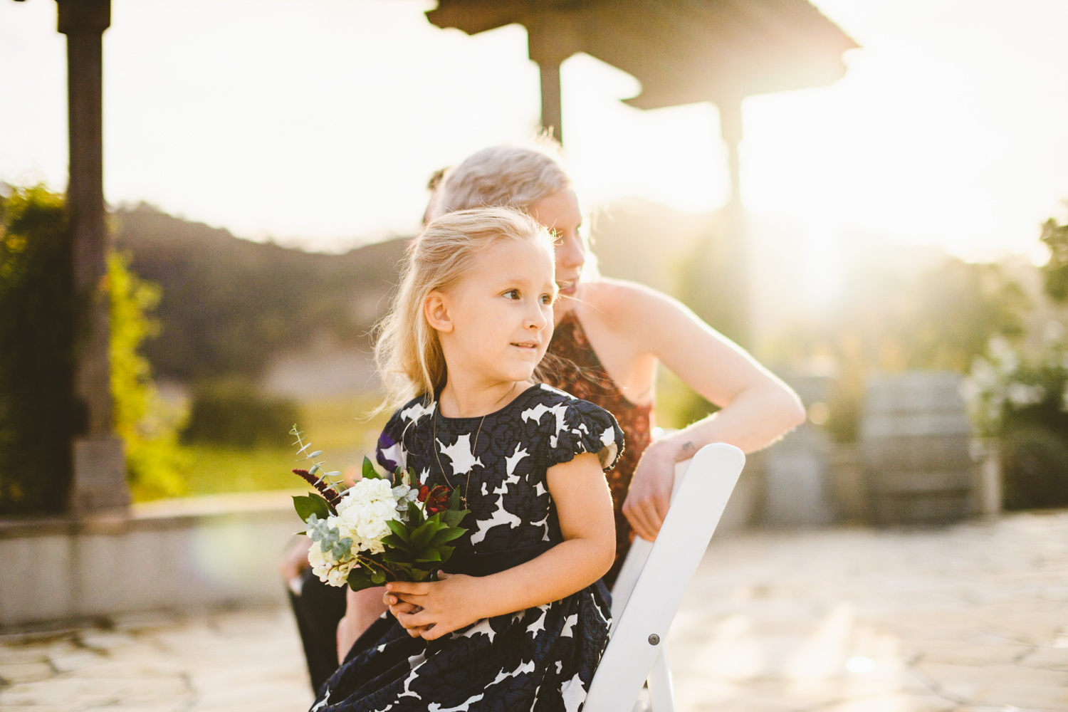 014 - daughter of the bride watches as bride walks down the aisle.jpg