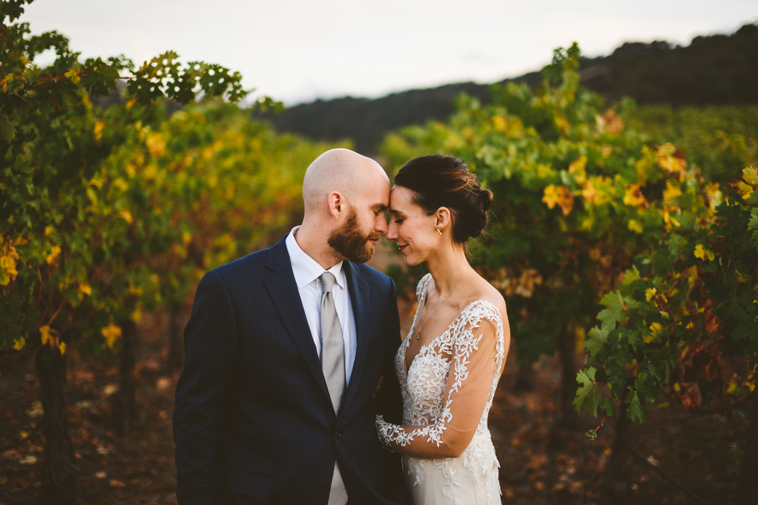 024 - bride and groom close their eyes and share an intimate moment near vineyard at clos la chance wines in san jose california.jpg