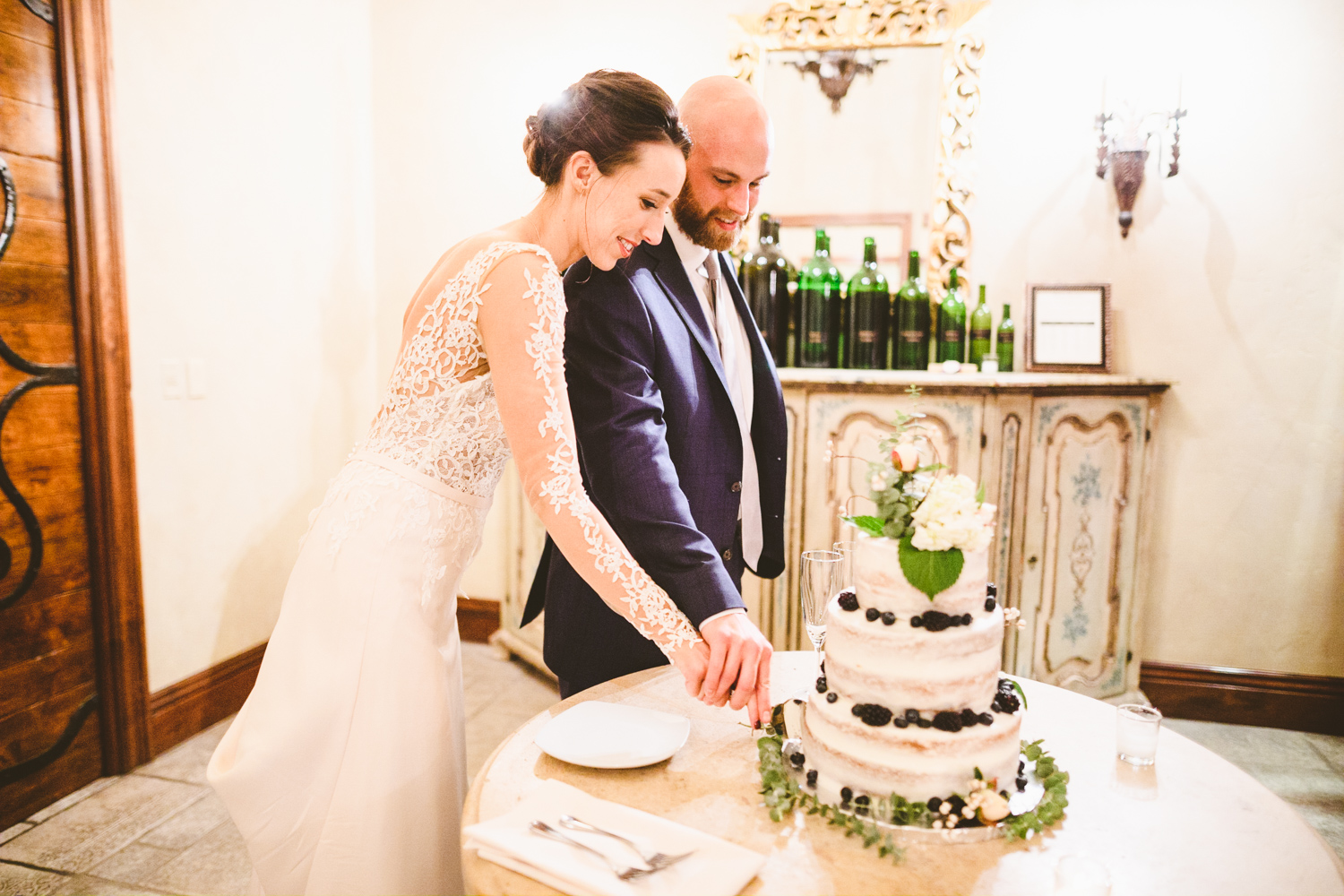 034 - bride and groom cut the cake at clos la chance winery.jpg