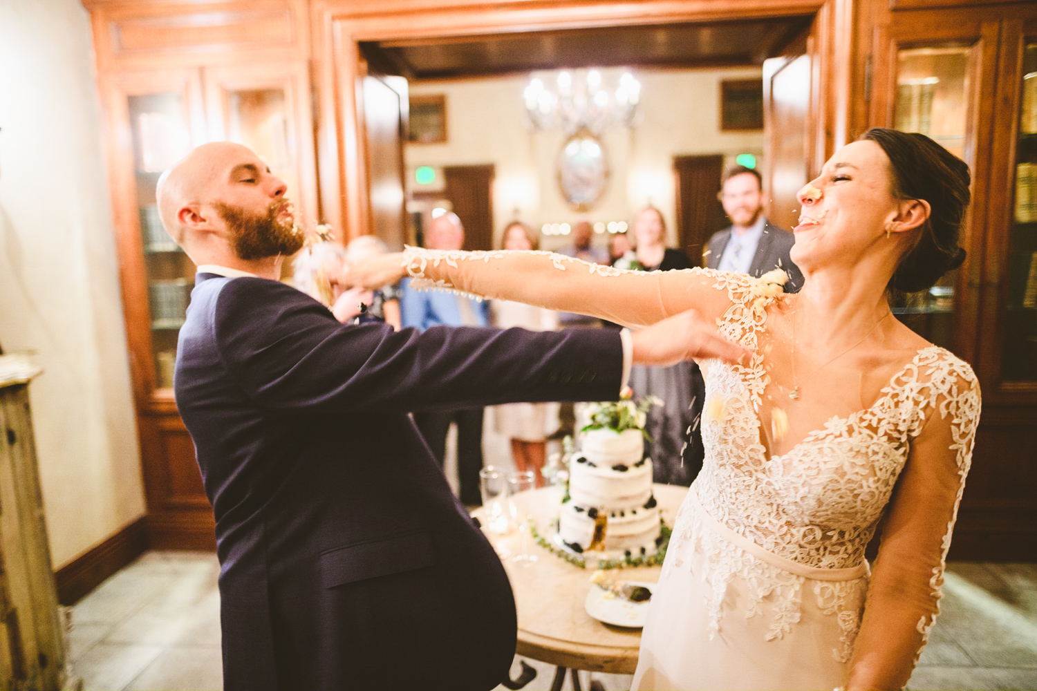 035 - bride and groom smash cake in each others faces.jpg